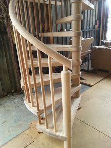 spiral light phil mahogany round rail posts and balusters